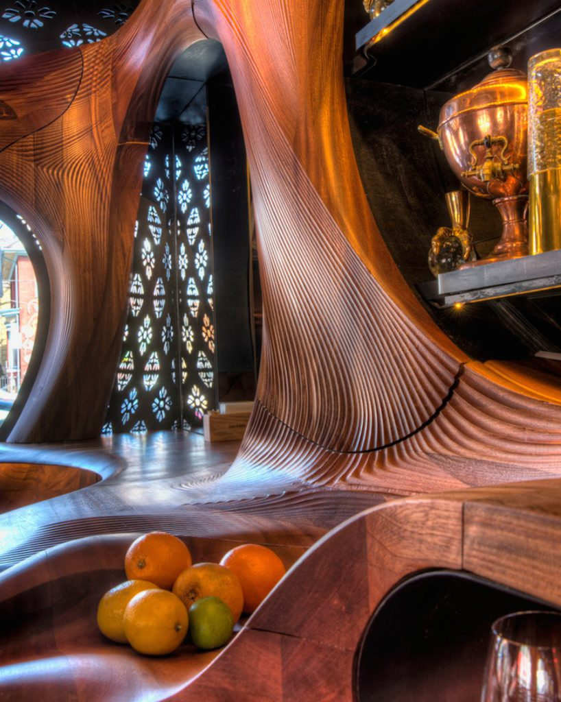 Interior design of Bar Raval with bowl of oranges and lime